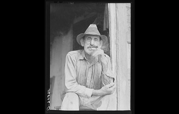 Isleño trapper taking a cigar break, Delacroix, 1941. Source: Library of Congress