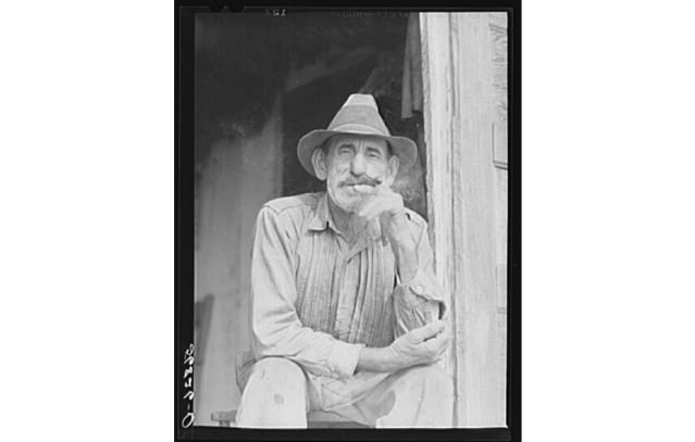 Isleño trapper taking a cigar break, Delacroix, 1941. Source: Library of Congress