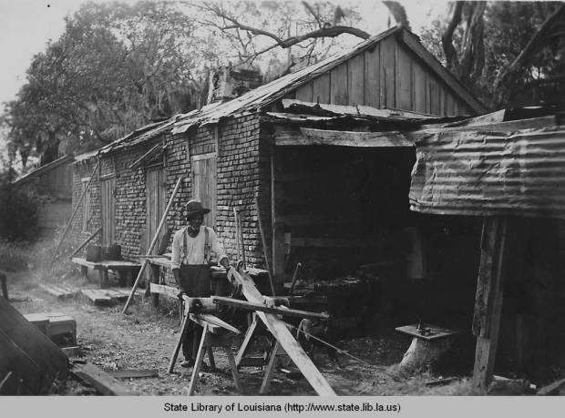 Man working outside old slave quarters, 1930s. Source: Louisiana Digital Library