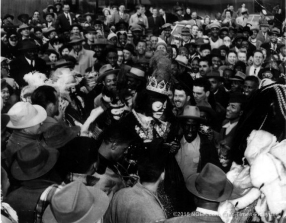 1949 - Louis Armstrong pushing through a crowd as he makes his entrance as Zulu King
