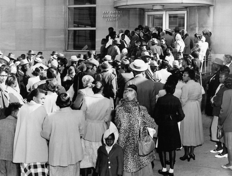 1953 - Crowd of African Americans wait for medical care outside Colored Wing of Charity Hospital
