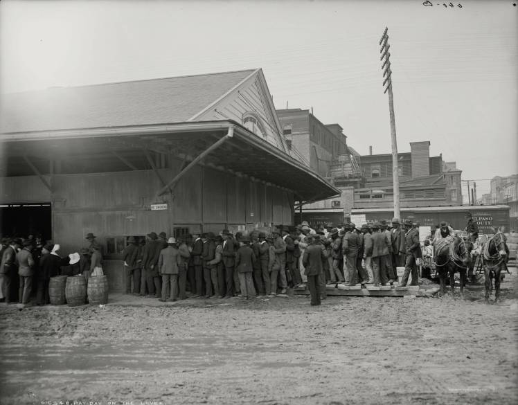 ca. 1900 - Pay-day on the levee