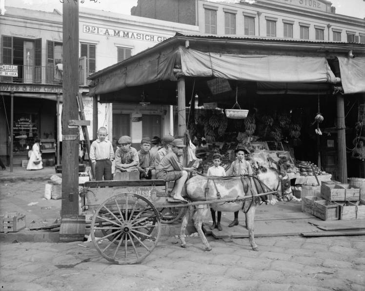 ca. 1910 - Kids at the French Market