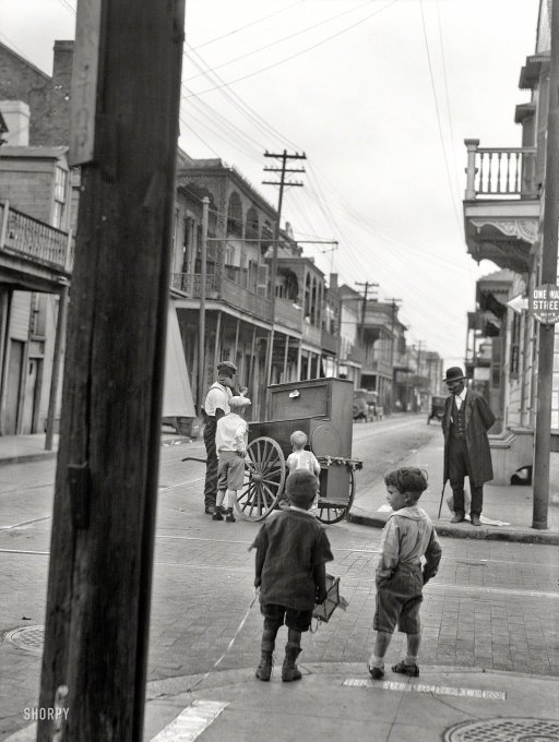 ca. 1925 - Organ grinder on Bourbon Street and Ursulines Avenue
